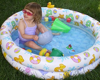 Enclosed is a picture of our granddaughter Cayla Monks from Greensburg, Pa. enjoying her backyard pool.  Check out the pink shades she loves to wear!! Donna & Joe Luther, Austintown.