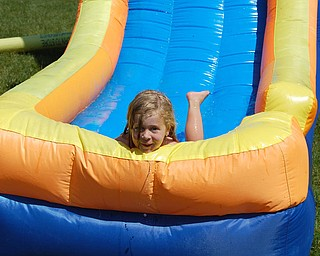 Sophia Yurich, 4 years old cooling off on her backyard waterslide in Poland.  Picture by mom, Kim Yurich.