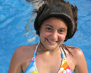 "Taylor Jones of Austintown making ""hairdos"" in Grandpa's pool!"