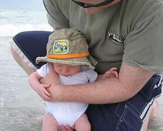 Thought I would send along this picture I took in May of our then 2 month old son Rowan Michael Downie (born 3/9/2008) dipping his feet into the Gulf of Mexico at Clearwater Beach, FL supported by my husband Brian Downie. I of course think it is adorable with my two favorite guys  : ) Kricket Downie