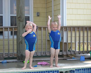 A.J. Barber and his cousin Keaton Mayhew salute before going in the water. Charisse Mayhew of Boardman is Keaton's mother.