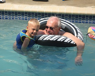Keaton Mayhew enjoys some time with his grandfather, Dominic Barber. Both are from Boardman.