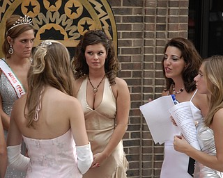 Judges Joanna Lenefonte, 20, of Boardman, right, front, and a local news anchor prep contestants before the Italian Queen Pageant at the Downtown Italian Festival in Youngstown on Friday, August 1, 2008. Daniel C. Britt.