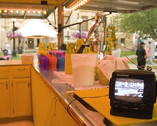 Slow traffic early in the day gave this lemonade vendor reason to leave a portable TV in charge of the stand. Daniel C. Britt.