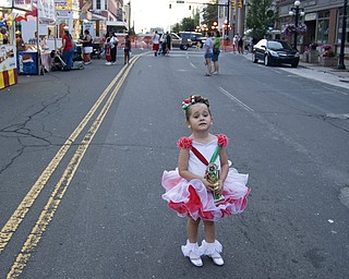 Morgan Rolley, 4, of Warren gets no comfort from her trophy while her mom steps away to buy a Gyro. Rolley was the runner-up in the Tiny Queen pageant. Warren Italian Festival Thursday, August 7, 2008. Daniel C. Britt.
