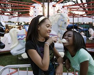 Ashley Brown bursts friend Angela Brown's bubble at the Warren Italian Festival Thursday, August 7, 2008. Daniel C. Britt.