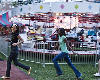 Tenacious Trio: L-R Warren residents Ashley Brown, 13, Angela Brown, 13 and McKenzie Montecalvo, 13, racing toward the next attraction at the Warren Italian Festival Thursday, August 7, 2008. Daniel C. Britt.