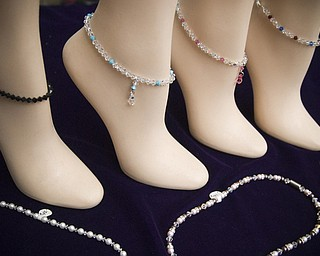 Casey Crystal of Pittsburgh, PA had on display handmade anklets at the Shaker Craft festival in Beaver Sunday, August 10, 2008. Daniel C. Britt.