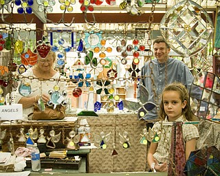 Terra Stevens, 7, of Dardenne Prarie, Missouri is a 3rd generation glass designer. Her family's company, Leaded Glass Design of Wadsworth, has had a booth at the Shaker Festival for over a decade. Daniel C. Britt.