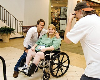 """CELEBRITY SHOT: """"Days of Our Lives"""" actor Shawn Christian poses with fan Judith McNear of Niles at Eastwood Field while McNear's friend Charles Benchia of Warren snaps a picture."""