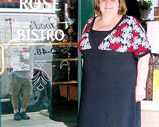 ORIGINATOR: Maria Longo stands at the door to the Green Rose Bistro, which she and her husband own. The Salem Italian Festival was her idea.