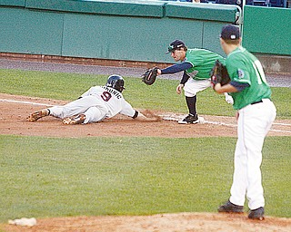 PICKOFF ATTEMPT: Scrappers pitcher, P.J. Zocchi, right, watches as first baseman Zach Booker, center, tries to tag out Andy Simunic of the Tri-City ValleyCats at first base during Sunday's game at Eastwood Field.