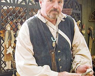 HANDIWORK: Art Blair of Girard uses a rasp to shape many of his wooden folk art sculptures. Shaker Festival, Beaver, OH Sunday, August 10, 2008.