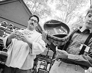 Joe Nelson, left, with his son Riley, 13, explain how some baskets are weaved to carry more load than others. Riley takes full credit, however, for the football idea. Shaker Craft Festival in Beaver Sunday, August 10, 2008. Daniel C. Britt.