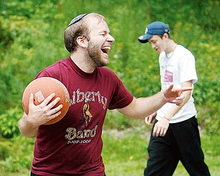 FUN GAME: Weisberg shares a laugh with friends while playing the game. In the background is Stoyak.