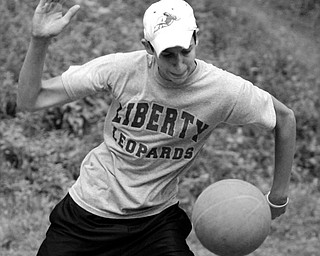 Tony Pozzutto serves the ball during a game of four square. He and some friends are trying to break the world record.