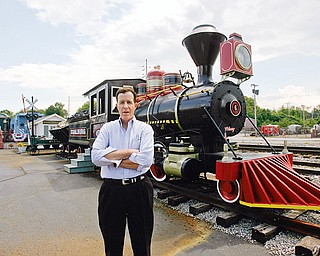 ENGINE PRESERVED: hubbard businessman J.P. Marsh stands near the 1910 Porter steam locomotive that he had reconditioned. The engine was used in carbon limestone mining in the Youngstown area until the 1960s. It's on display at the rear of the Emeral Diner in Hubbard.