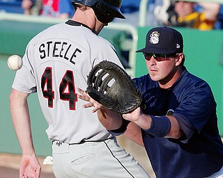 NOT THIS TIME: Scrappers first baseman Zach Booker, right, waits to make the catch as ValleyCats baserunner T.J. Steele gets back to first safely during a pickoff attempt Monday at Eastwood Field.