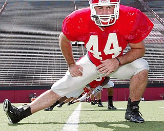 LINEBACKER PREPARATION: Linebacker Mike Barlak works his legs during Youngstown State's football practice on Monday.