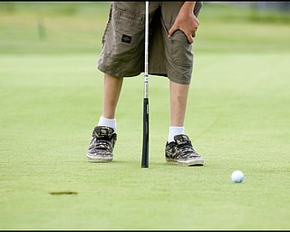 8.12.2008 Kids golfing to win a free set of clubs and a scholarship for free lessons from First Tee Foundation.
