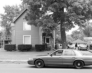 A house in the 800 block of N Park Ave. was surrounded and entered by Warren Police Tuesday afternoon in search of a person of interest in the murder of a restaurant owner and serious wounding of his son.