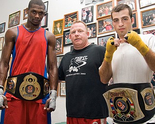 WINNERS: Wesley Triplett, 22, of Youngstown, left, poses with Kelly Pavlik's trainer Jack Loew, center, and fellow amateur champion Chris Hazimihalis, 23, also of Youngstown at the Southside Boxing Club. The boxers won titles last weekend.