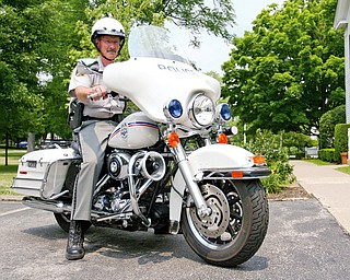 SMART SOLUTION: Russ Beatty, Poland Village police chief, rides one of the department's two Harley Davidson motorcycles, which were purchased with seized drug money. Some police agencies are using motorcycles and bicyclees to save money and gain an advantage over criminals. Two-wheeled options save fuel, and the initial equipment costs are lower than equipping a police car.