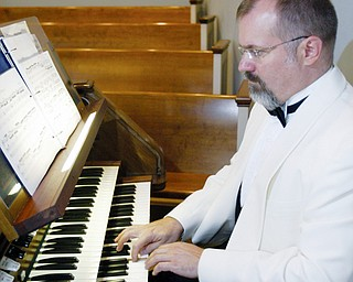 NOTEWORTHY EVENT: Thomas Pavlechko, cantor and composer-in-residence at St. Martin's Lutheran Church in Austin, Texes, rehearses to get into peak-performance level for an organ concert set for 7 tonight at Calvary Baptist Church in Boardman, where he once served as organist. The former Mahoning Valley resident coached actor Brad Pitt on the organ and piano for an upcoming movie.