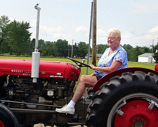 Arlow Parsons, of Southington, drives one of 40 tractors. The 10-mile parade took about an hour.
