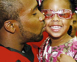 In this photo from Youngstown State's annual football media day in 2008, Tyler Griffin kisses his daughter.