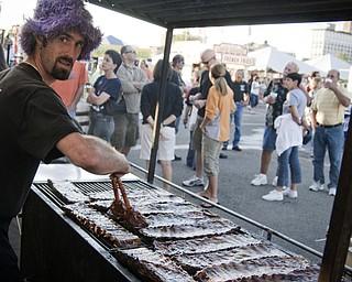 Anthony Ray soaks some ribs Saturday, August 16, 2008. Daniel C. Britt.
