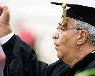 MAKING A POINT: Carl Nunziato, an Army veteran who suffered combat wounds in the Vietnam War, delivers the commencement address.
