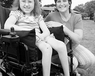 AT HOME: Sarah Williams, 12, and her mother, Terri, sit behind their Poland home where their neighbors, Kara and Alex Thompson, staged a fund-raising carnival for Sarah last month. Sarah suffers from a rare, progressive, genetic disease that affects the brain and spinal cord.
