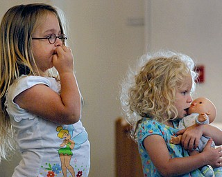 Makenzie Fink and Angelina Jannone both of Austintown watch as Sara Churchill entertains them.