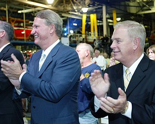 GM's Rick Wagoner, left, and Ohio Gov. Ted Strickland during unveiling of the new Chevy Cruze at GM Lordstown Thursday.