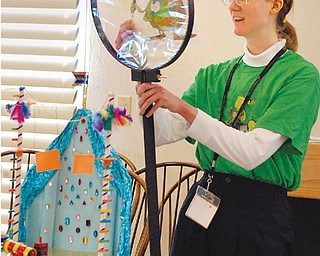 Sara Churchill entertains the children at Austintown Library with various activities