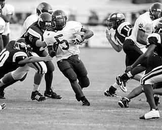 BIG WHOLE -  Fitzgerald Toussaint - runs one through as he breaks for a touchdown