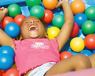 Aiyna Moore, 3, of Youngstown in the ballpit at Community Day at the Rockford Village in Youngstown Saturday, August 23, 2008. Daniel C. Britt.