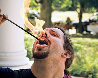 Travis Fessler, 35, plays with fire at the North side farmers market, Saturday, August 23, 2008. Daniel C. Britt.