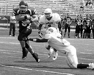 MCDONALD - YOUNGSTOWN CHRISTIAN - (9) Alex Sampson of McDonald score as (21) Carlen Sims and (1) Ryan Davenport can't make the stop Saturday afternoon in Canfield. - Special to The Vindicator/Nick Mays