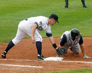 NOT IN TIME: State College's Butch Biela beats the tag of Robbie Alcombrack Sunday at Eastwood Field.