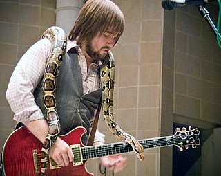 The Zou invited a 6 foot peruvian boa constrictor onto the stage at Rukus fest in Warren. Guitarist Rob Thorndike, 23, of Youngstown soloed with it wrapped about him like a slimy shawl.