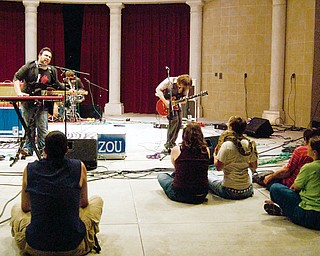 The Zou invited audience members on stage during an intimate performance at the Rukus festival in Warren Sunday August 24, 2008.