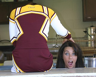 """""""Senior Cheerleader Christina Oddo seems to have lost her head!  There is just so much to do to get ready for the 2008 Football Season!"""""""