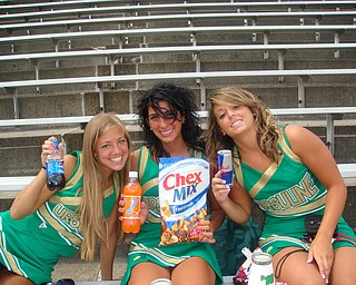 Ursuline Cheerleaders Ashley Williams, Cara Mia Gatti and Nina Ballone are feuling up for the season in their new uniforms on picture day!