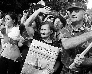 INDEPENDENCE RALLY: People holding Russian newspapers attend a rally in Tskhinvali, capital of Georgia's breakaway province of South Ossetia. The rally Wednesday was to celebrate Russia's recognition of the independence of South Ossetia.