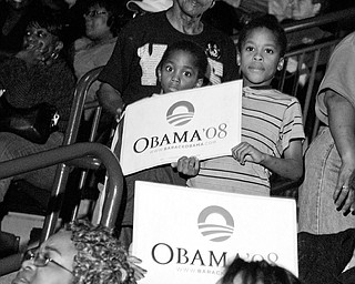 HISTORIC MOMENT: Monique Talley, 8, and Desirae Hariston, 7, were on hand at the Chevrolet Centre to watch Barack Obama's acceptance speech. The Democratic nominee for president spoke of his hopes for his own children going into America's future.