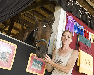Tericia Heasley of Canfield poses with her Welsh pony mare, Echo. Echos's stable took two das to decorate. Canfield Fair Saturday, August 30, 2008. Daniel C. Britt.