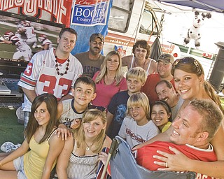 First Row, L-R: Dan Collela, 27, of Columbus and Macy Sicklesmith, 26, of Naples, Fl.  Second Row: Paige Hawkins, 15, of Columbiana; Hannah Vollnogle, 15, of New Waterford; Keenan Green, 9, of Columbiana; and Shana Sepulveda, 17, of Beaver Creek.  Third Row: Saxon Sepulveda, 11, of Beaver Creek; Chase Green, 12, of Columbiana; and Dave Collelo, 50, of Beaver Creek.  Fourth Row: Adam Booth, 28, of New Waterford; Candy Hawkins of Columbiana; and Jason Booth, 33, of New Waterford.  Fifth Row: Mike Hawkins and Cindy Neville, both of Columbiana.   The group set up camp at the Canfield Fair with a Plasma TV, a Nintendo Wii, the Guitar Hero video game and a pinata. Saturday, August 30, 2008. Daniel C. Britt.