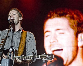 Josh Turner getting crazy with his guitar at the Canfield Fair Sunday, August 31, 2008. Daniel C. Britt.